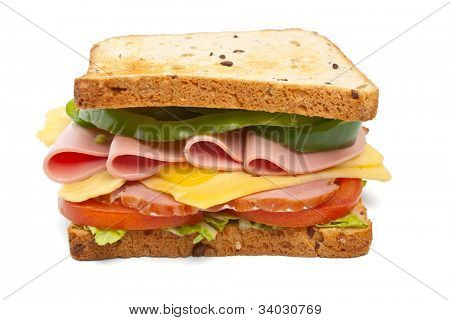 meat, lettuce, cheese and vegetables big sandwich on toasted whole wheat bread