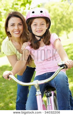 Girl on bike with mother
