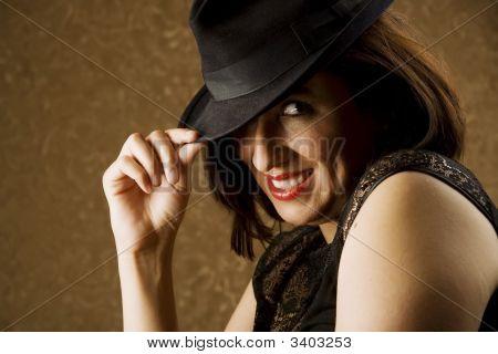 Hispanic Woman Tipping Her Hat