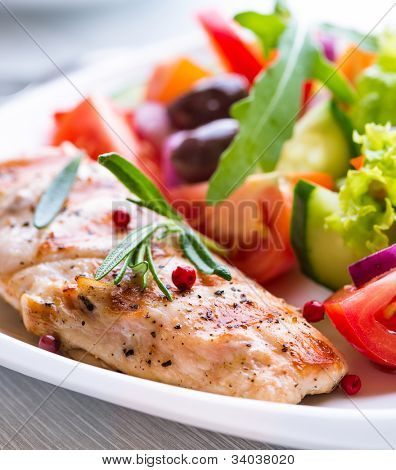 Grilled chicken fillet with vegetable salad