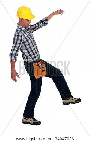 Tradesman walking across a tightrope