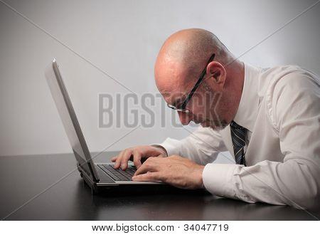 Bored businessman using a laptop