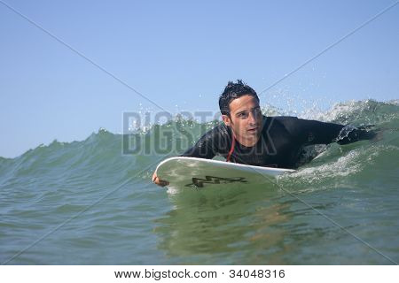 Man surfing wave