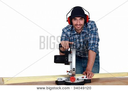 Man using a mitre saw