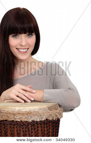 Brunette playing bongo drum