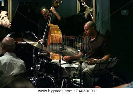 MADISON, NJ - JUNE 16: Drummer Dion Parson (R) and bassist Holt Corcoran (C) of the Steve Turre Quartet perform at Shanghai Jazz on June 16, 2012 in Madison, NJ.