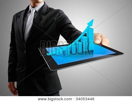 Businessmen, hand  touch screen graph on a tablet