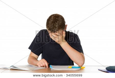 Teenager Overwhelmed By His Studies