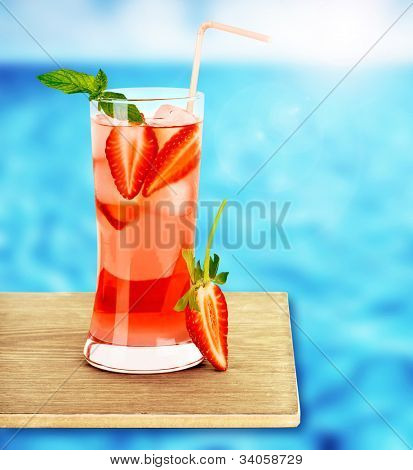 Strawberry juice on the poolside, fresh red berry tropical cocktail on wooden tray, cafe outdoor, beach restaurant, icy cold drink, healthy beverage, vacation and diet concept, food style and design