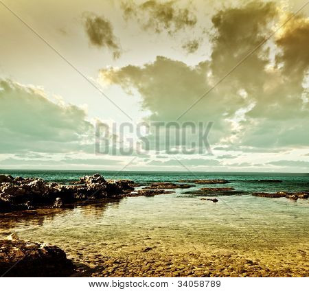 Grunge sea landscape, beautiful peaceful seaview, calm ocean water, summer beach, nature background, old postcard with cloudy sunset