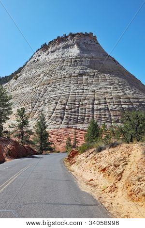 A bright sunny day in Zion National Park. The road passes close to the famous Checkerboard hill.