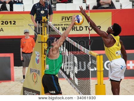 MOSCOW, RUSSIA - JUNE 8: Thiago Santos Barbosa (right) and Ferramenta, Brazil vs McHugh and Joshua Slack (left), Australia, during Beach Volleyball Swatch World Tour in Moscow, Russia at June 8, 2012