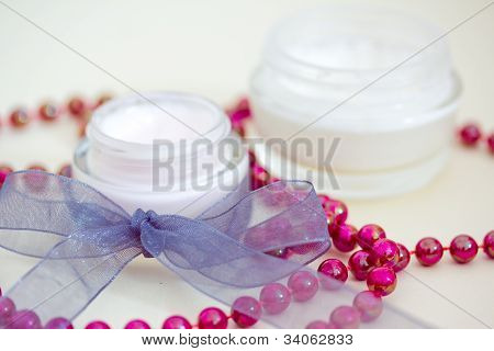 Luxury Spa Products And Red Beaded Necklace