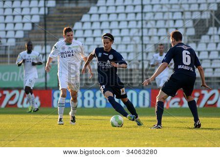 KAPOSVAR, HUNGARY - MAY 27: Tamas Horvath (white 10) in action at a Hungarian National Championship soccer game Kaposvar (white) vs Zalaegerszeg (black) May 27, 2012 in Kaposvar, Hungary.