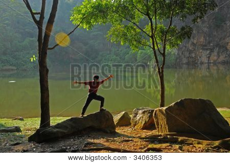 Man Doing Exercise At The Lake Sides