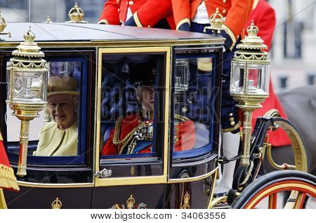 LONDON, UK - JUNE 16: Queen Elizabeth II and the Duke of Edinburgh during Trooping the Colour ceremony on the Mall and at Buckingham Palace, on June 16, 2012 in London.