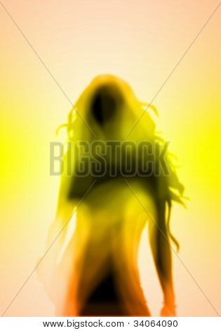 Female silhouette against colour background