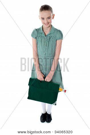 Full Shot Portrait Of Smiling School Girl