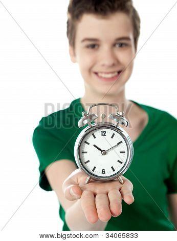 Adorable Boy With A Alarm Clock
