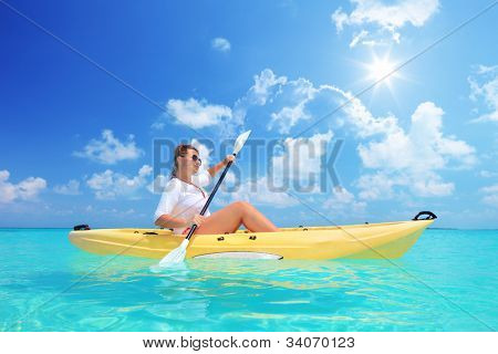 A female kayaking on a sunny day, Kuredu island, Maldives, Lhaviyani atoll