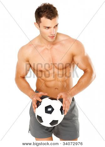 Handsome man holding soccer ball on white background