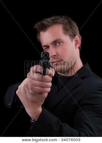 Young man aiming with a gun