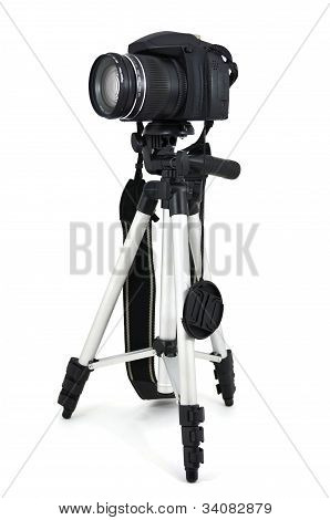 Black digital camera on a tripod