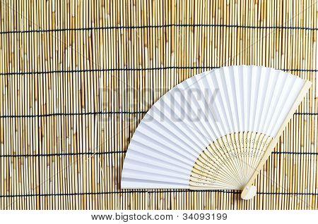 Japanese Folding Fan On Bamboo Blind Background.