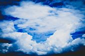 Blue Sky With Cloud Closeup . Sunlight With Blue Sky On Dark Background.vivid Sky On White Cloud. Na poster