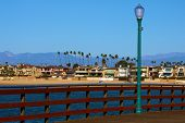 Wooden Pier Overlooking The Pacific Ocean And The Beach Taken At The Seal Beach, Ca Pier On The Cali poster