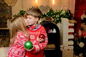 Little Girl Kissing Little Boy On Christmas Background. Christmas Little Couple In Love. Wish You Me poster