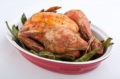 whole roasted chicken with green beans in a dish
