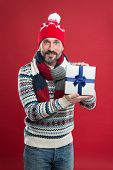 Caucasian Man Wear Warm Clothes Hold Present Package. Winter Trends. Knitted Hat Scarf Sweater. Wint poster