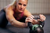 Woman Resting During Kettlebell Workout