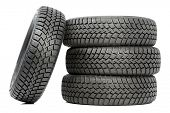 stock photo of four-wheel drive  - Stack of four wheel new black tyres for winter car driving isolated on white background - JPG
