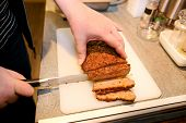 Woman Hands Cutting Piece Of Meatloaf, She Prepare For Tasting Of Food At Kitchen. Chef Cutting Meat poster