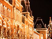 Illuminated Lights On Facade Of Gum Festive Background. Christmas Illuminations And Decorations Of C poster