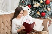 Reading Is Always A Good Idea. Little Girl Read Book To Toy Friend. Small Child Enjoy Reading Xmas S poster