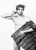 Guy Attractive Rich Posing Fur Coat On Naked Body. Fashion And Pathos. Rich Athlete Enjoy His Life.  poster