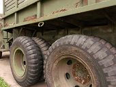 foto of humvee  - Authentic older army truck tires shot yielding wear - JPG