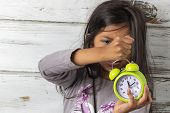 Little Girl Waking Up With An Alarm Clock poster