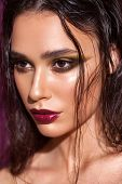 Close Up Portrait Of A Beautiful Girl With Trendy Golden Eyeshadows, Rich Eyebrows, Marsala Lipstick poster