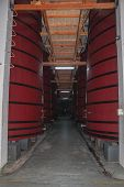 Corridor With Several Tanks For Storage And Wine Aging At The Aurora Winery Production Plant In Bent poster