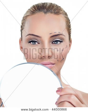 Cosmetic correction surgery, woman before plastic surgery looking in mirror