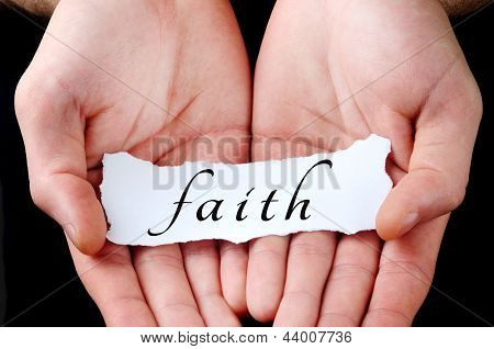 Man Holding Faith Word
