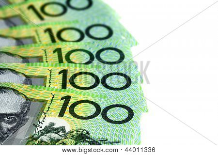 Australian one hundred dollar bills fanned over white background.