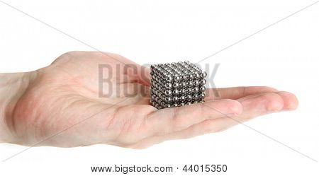 Neocube (toy) on man hand, isolated on white