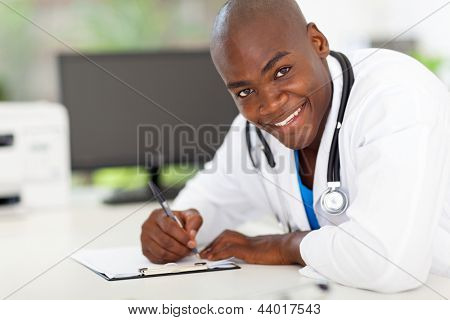portrait of afro american male doctor working in office