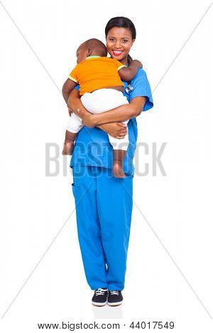 pretty african nurse carrying a child isolated on white