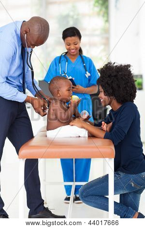 male african american pediatrician examining baby boy